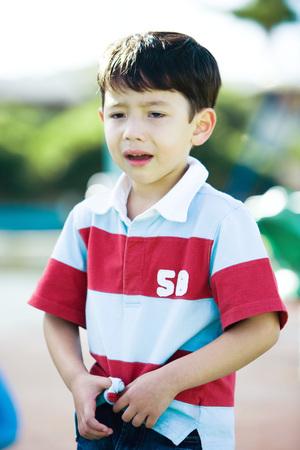Boy crying on playground