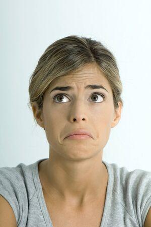 Woman making sad face, portrait