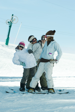 kids at the ski lift: Group of snowboarders posing in snow, full length