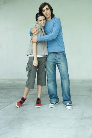 Teenage couple, full length portrait LANG_EVOIMAGES