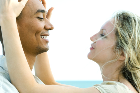 multi racial: Couple face to face with eyes closed, woman touching mans head LANG_EVOIMAGES