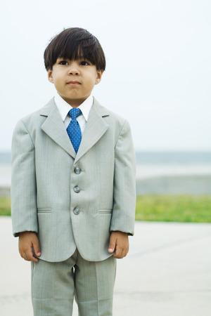Boy dressed in full suit, three quarter length