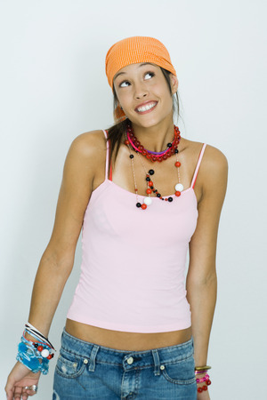 Teenage girl wearing bandana, smiling  and looking up LANG_EVOIMAGES