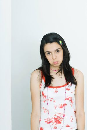 Teenage girl pouting, looking at camera, portrait