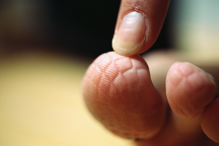 Finger touching toe with imprinted pattern, extreme close-up LANG_EVOIMAGES