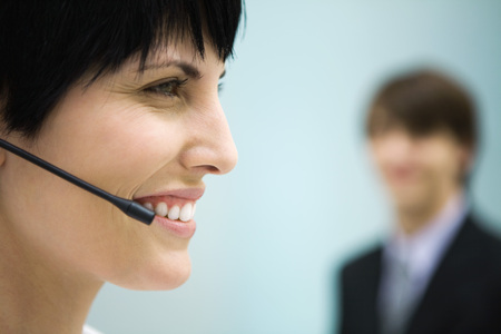 Woman using headset, profile, close-up LANG_EVOIMAGES