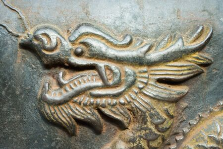 Bronze dragon in relief, close-up