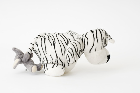 Stuffed toys, elephant pulling tigers tail