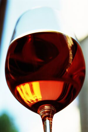Red wine glass, close-up, low angle view