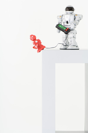 Robot playing with smaller remote control robot