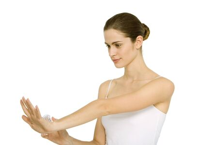 Woman looking at fingernails, holding nail brush, smiling LANG_EVOIMAGES