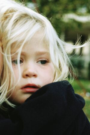 Little girl looking away, frowning, portrait