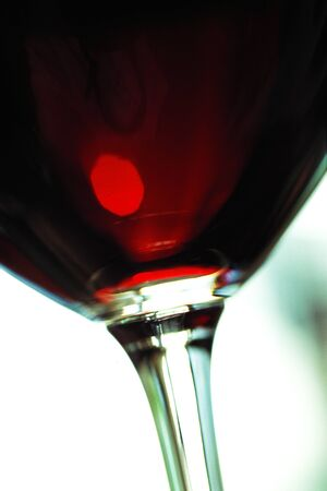 in low spirits: Red wine in glass, close-up, cropped