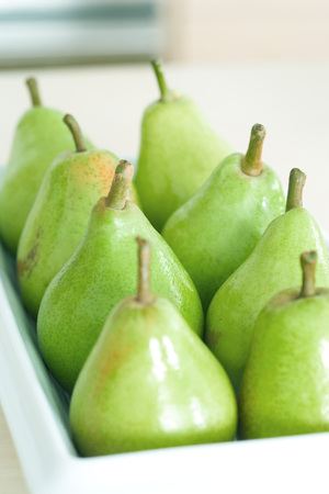 Pears lined up on tray, close-up