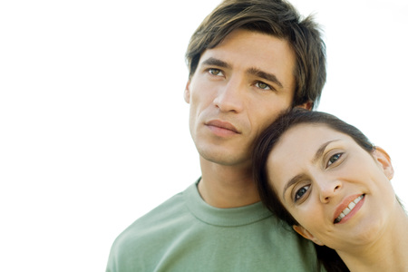 Woman leaning head against mans shoulder, smiling at camera