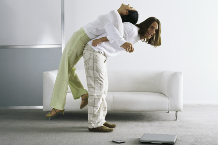 Man lifting woman on back