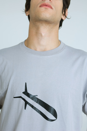 Young man wearing tee-shirt with bomb graphic, cropped