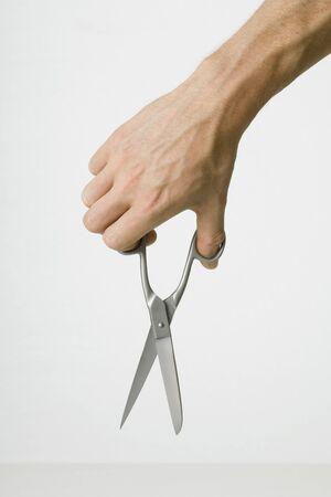 Hand holding scissors, close-up
