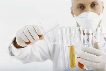 Researcher transferring liquid to test tube LANG_EVOIMAGES