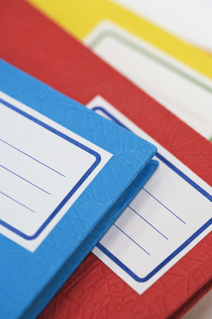 blanks: Pile of school notebooks with blank labels LANG_EVOIMAGES