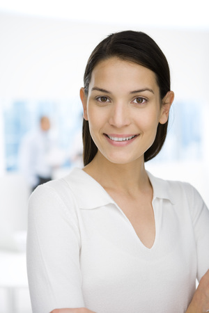 Young professional woman smiling at camera, portrait
