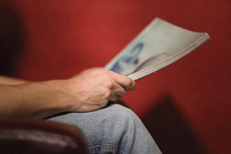 Man reading magazine LANG_EVOIMAGES