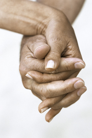 Couple holding hands, cropped view
