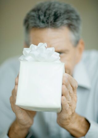 Man holding up gift