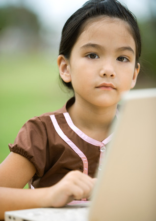 distractions: Girl using laptop