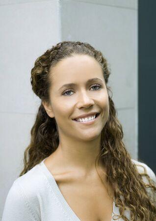 Woman smiling, head and shoulders, portrait