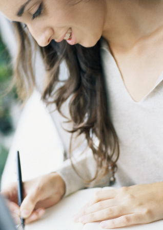 Young woman writing, close-up