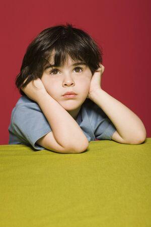 Little boy daydreaming, portrait