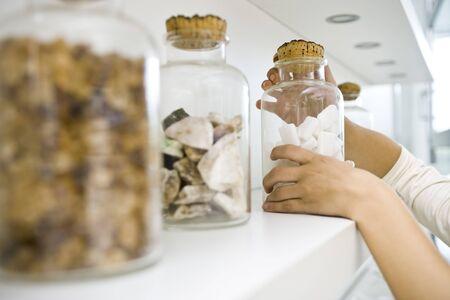 Getting down ingredient jars from shelf