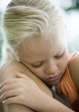 Girl leaning head against knee
