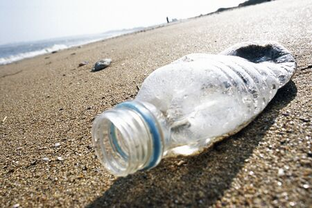 Plastic bottle on beach LANG_EVOIMAGES