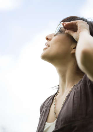 Woman looking at sky LANG_EVOIMAGES