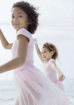 Two girls running on beach