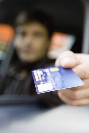 thru: Customer in drive-thru holding out credit card