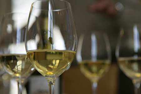 in low spirits: Glasses of white wine