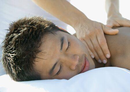 holistic view: Man receiving back massage