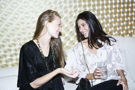 Friends chatting at nightclub LANG_EVOIMAGES
