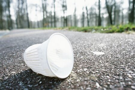 Plastic cup on road LANG_EVOIMAGES