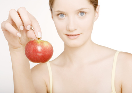 Woman holding up apple