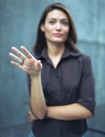 persuade: Woman gesturing, defocused