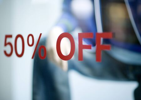 50% off sign on store window LANG_EVOIMAGES