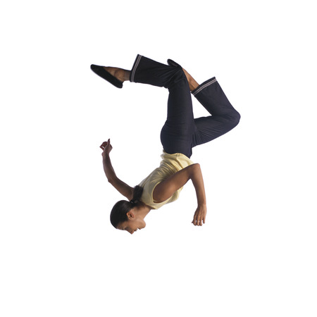 Woman flipping in air, side view