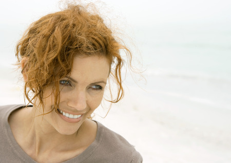 messed: Woman smiling on beach