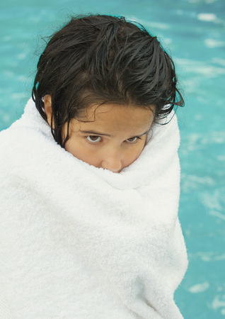 unease: Girl wrapped in towel, pool in background