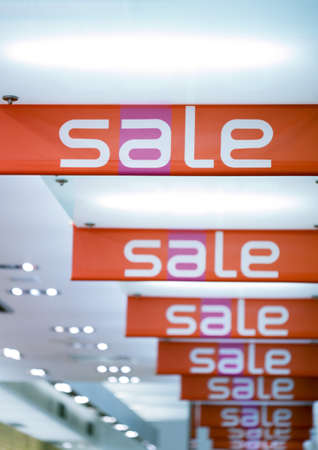 Sale signs hanging from ceiling