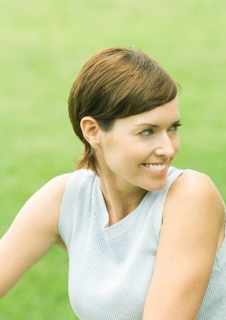 distractions: Woman looking over shoulder, smiling